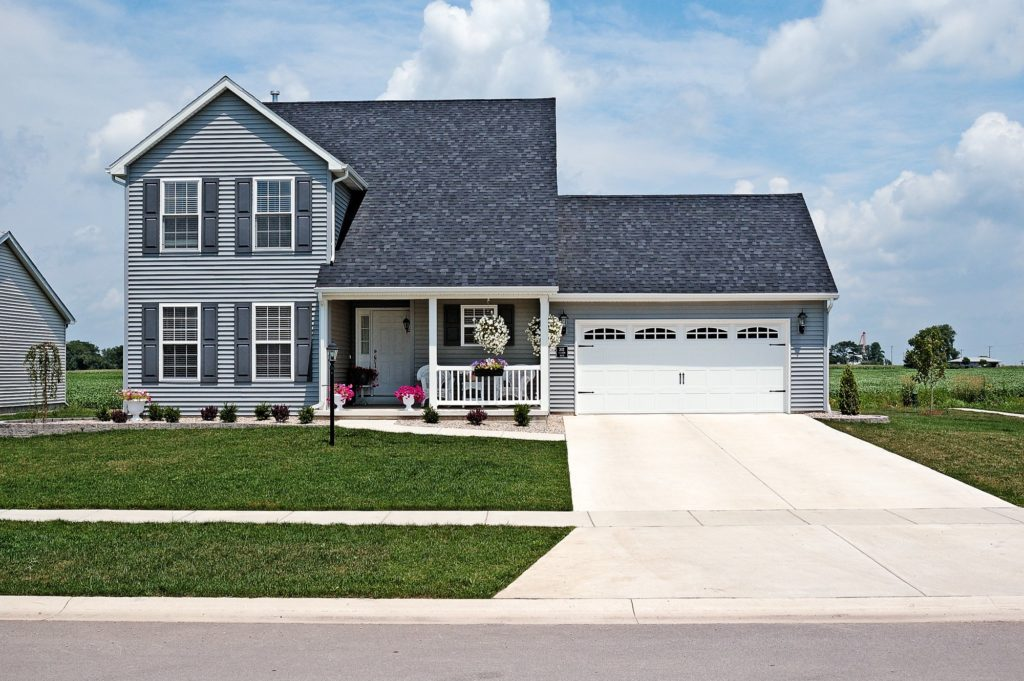 Stamped Carriage House Short shown in White with optional Cascade widow inserts and Spade hardware