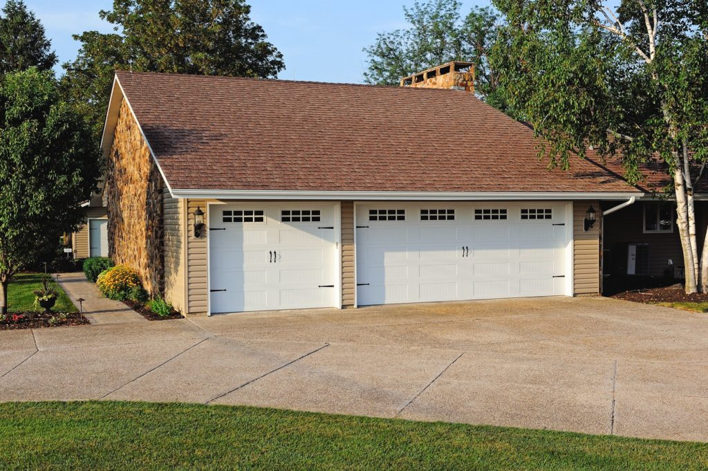Stamped Carriage House Long shown in White with optional Plain glass, Stockton window inserts and Spade hardware