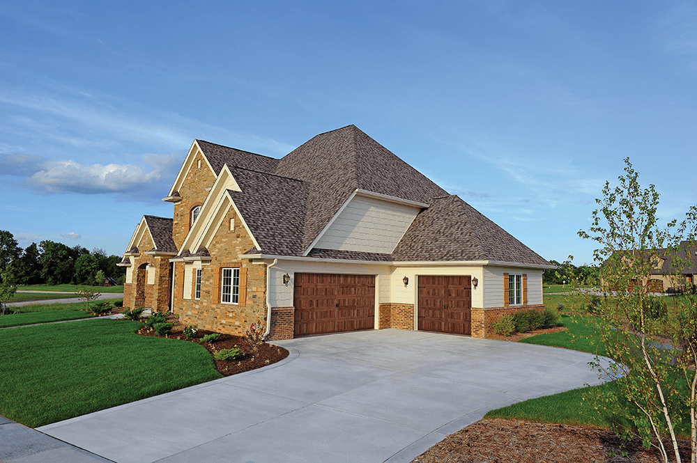 Stamped Carriage House shown in Dark Oak with optional Spade hardware