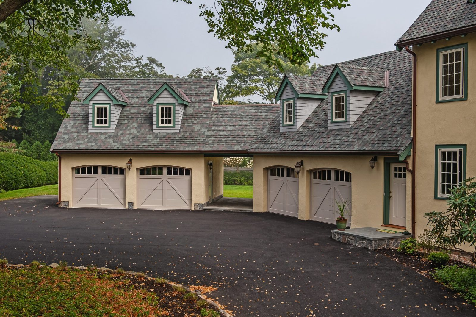 Overlay Carriage House Steel shown in Sandstone with optional Arched Madison windows.