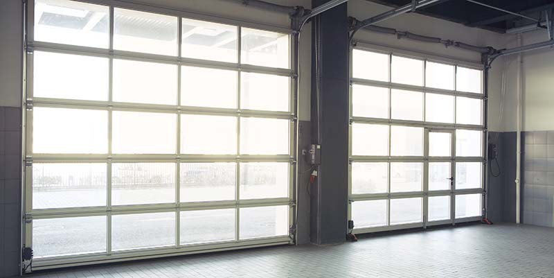 Empty Interior Auto Garage Door— garage door services in Katy TX