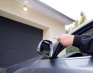 Man Using Remote Control to Open Garage Door from the Comfort of His Car
