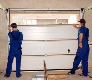 Technicians Doing a Garage Door Replacement— Garage Service Pros